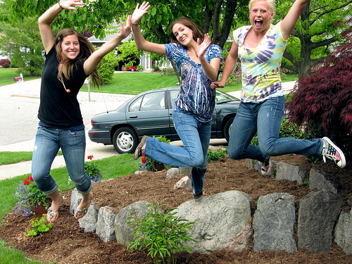 happy teen girls jumping